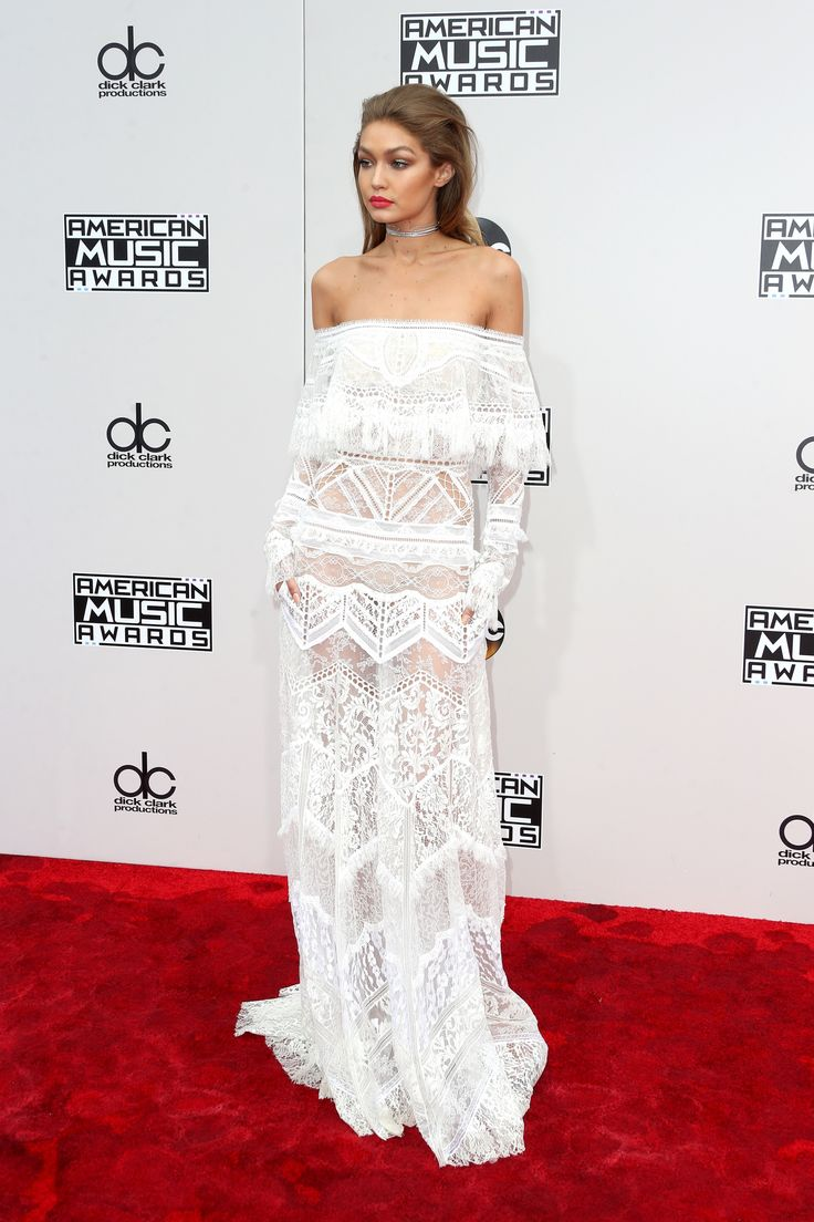 Hello gorgeous! Host Gigi Hadid slayed the red carpet in a white lace Roberto Cavalli number. She paired the off-the-shoulder look with a sexy red lip and diamond choker. (Photo by Frederick M. Brown/Getty Images)  via @AOL_Lifestyle Read more: http://www.aol.com/article/entertainment/2016/11/20/american-music-awards-2016-red-carpet-arrivals/21610362/?a_dgi=aolshare_pinterest#fullscreen