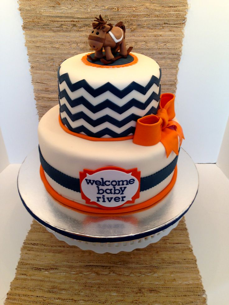 Rocking horse cake with chevron in blue and orange.  #Rocking horse cake #blue orange theme cake #Chevron cake