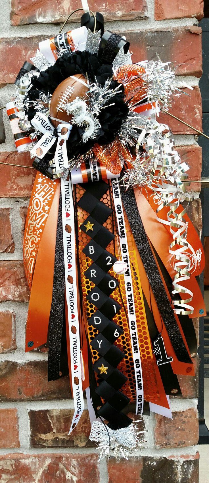 Boys Garter homecoming mum. Orange black white and silver homecoming mum. Designed by Crafty bug