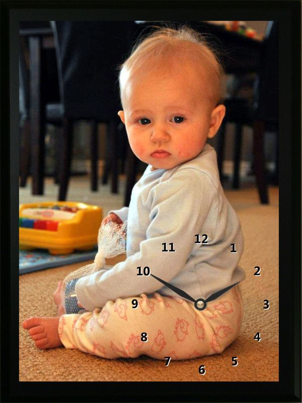 This Baby Sitting Clock is a great reminder of when this little girl was just a baby. Custom Photo clocks are a great way to remember your child's past.