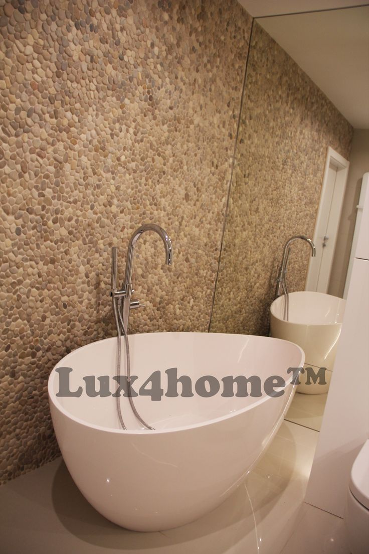 Beige Pebble Tile Walls Bathroom. We are looking for importers from your country.  Interlocking Tiles Beige pebble. See our full collection of stone pebble mosaic.  #pebble #pebbletile #pebbletiles #pebblewall #pebblebathroom #pebbleshower #pebblemosaic #pebblestone #pebblemanufacturer  Lix4home - pebble tile manufacturer and exporter in Indonesia.