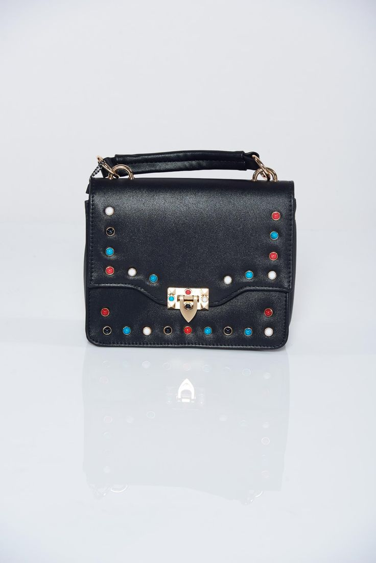 Black casual bag metallic spikes, women`s bag, two compartments and inside pockets, metallic spikes, includes a long handle, insole material: fabric textil, upper material: ecological leather