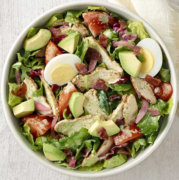 Chicken raised without antibiotics, arugula, romaine, kale and radicchio blend, vine-ripened tomatoes and pickled red onions tossed with freshly made Green Goddess dressing and topped with avocado, bacon, and cage-free hard-boiled egg. Available in whole and half. (Nutritional values below are based on whole serving. For detailed nutrition facts on all items based on serving size, please download our <a href=