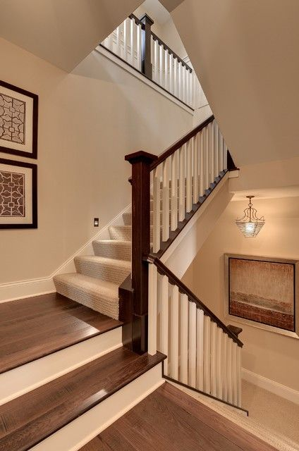 prefinished hardwood Staircase Traditional with beige painted wall carpet runner carpeting dark brown handrail