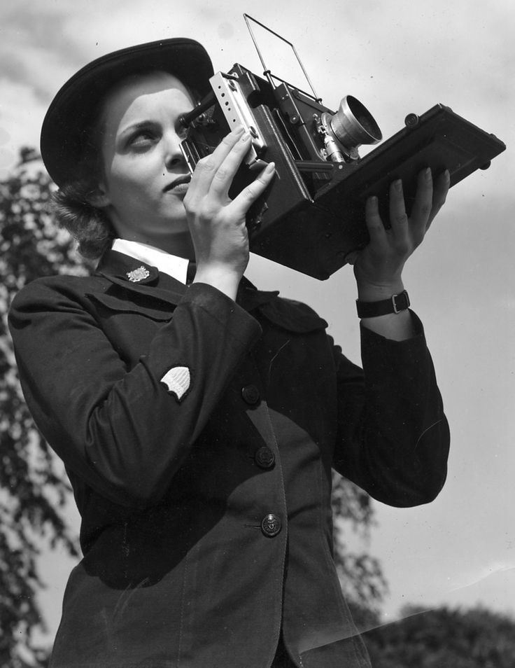 U.S. Coast Guard (SPARS) photographer with her 4x5 Anniversary Speed Graphic camera. The term SPARS comes from the contraction of the Coast Guard motto: Semper Paratus and its English translation, Always Ready. The name also refers to a spar in nautical usage.