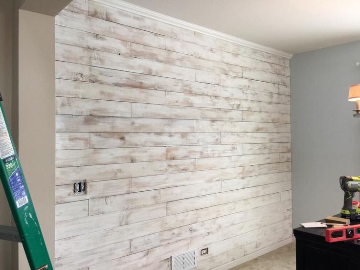 Dinning room wall did using Cedar wood fence board. Then white washed with regular eggshell latex paint.
