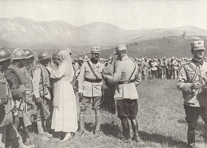 Queen Marie of Romania / decorating soldiers at the front The Sphere, 9 March 1918