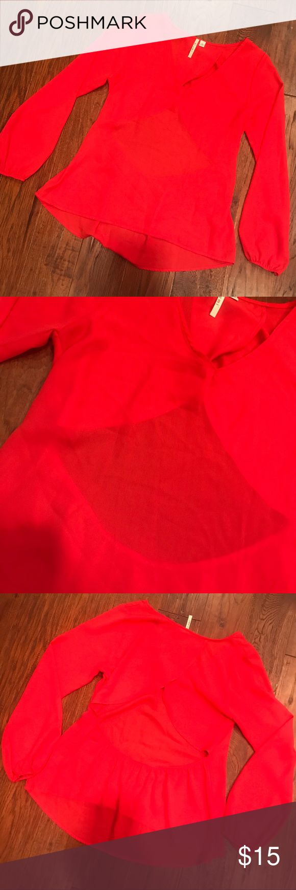 NWOT Coral Blouse with Open Back Cute coral colored blouse that has an open v in the back. Brand new! miami Tops Blouses