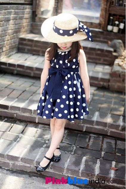 Get this wonderful baby gown for your cute little princess. Shop online the fashionable and smart blue baby gown with white polka dots scattered all over the dress