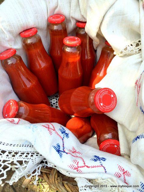 Homemade tomato broth bottled for winter