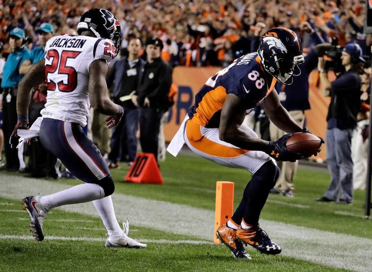 Monday Night Football: Texans vs. Broncos:     October 24, 2016  -  27-09, Broncos  -     Denver Broncos wide receiver Demaryius Thomas scores a touchdown as Houston Texans cornerback Kareem Jackson defends during the first half of an NFL game, Monday, Oct. 24, 2016, in Denver.