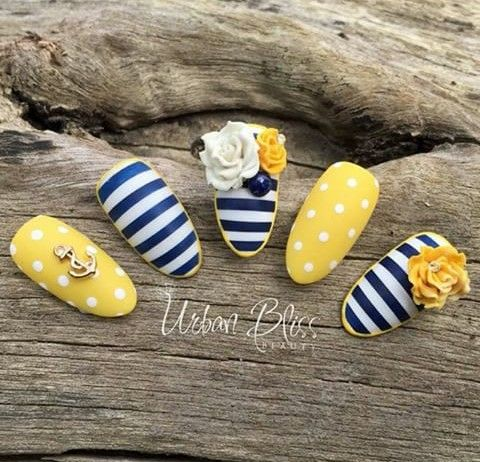 Yellow with white dots, white and navy blue stripes with a yellow trim, and a gold anchor and 3D roses