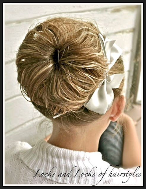 Tons of cute hairstyles on this woman's blog (and they're for long hair! YAY.)