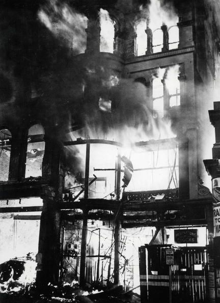 London,circa 1940: Fire rages in London shops and business premises on Ludgate Hill near St. Paul's after heavy bombing raids (Photo by Popperfoto/Getty Images)
