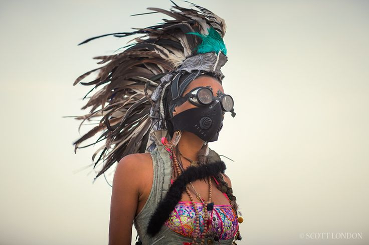Rizia, a first-time burner from Brazil, wearing goggles and a dust mask in a wind storm at Burning Man 2015. (Photo by Scott London)