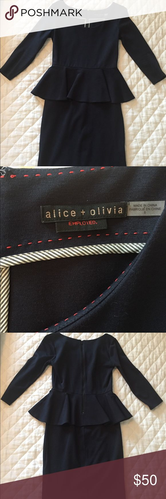 Alice & Olivia Navy Peplum 3/4 sleeve Work Dress Alice & Olivia Employed. Navy peplum work dress. Rayon and polyester. Body-hugging. Peplum creates appealing curves, material is very comfortable. Lightly worn. Alice & Olivia Dresses Mini