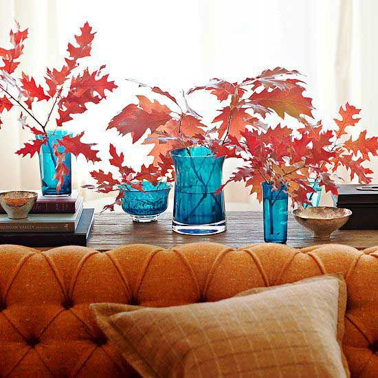 Love the color combination of blue vases and orange leaves! #fall #home #decor
