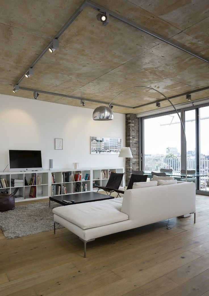 Great white modern couch done by Whitmore Rd Project by Trevor Horne Architects