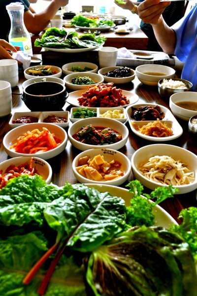 Typical Korean table - the table is about to break from so much food! [PHOTO]: