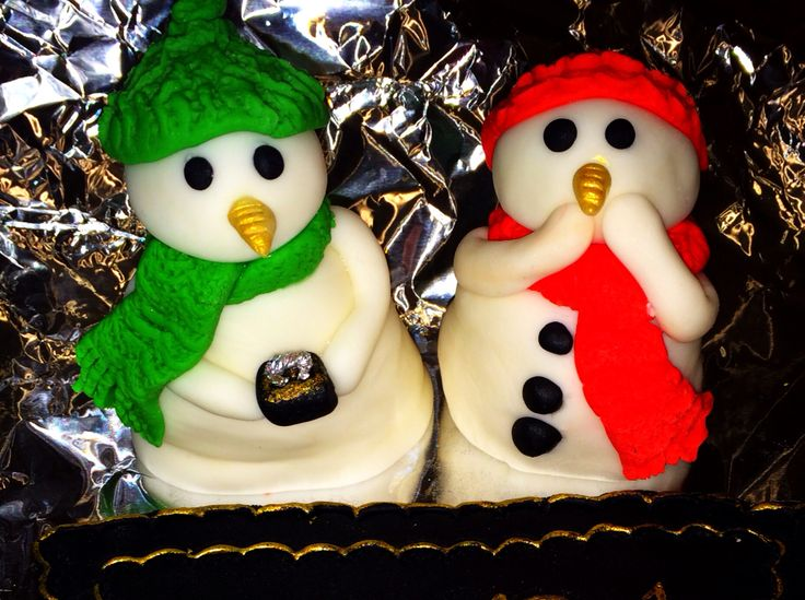 Fondant sugar craft snowman. Christmas engagement cake decoration.