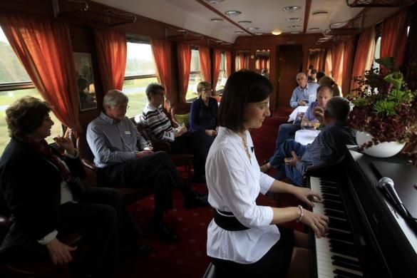 Passengers enjoy piano music in the bar car of a historic Tehran-bound train as it leaves Budapest October 15, 2014. REUTERS/Bernadett Szabo. visit http://www.budpocketguide.com #Iran #Persia #Tehran #Budapest #TravelToIran #MyIran #Travel2Budapest #MyBudapest