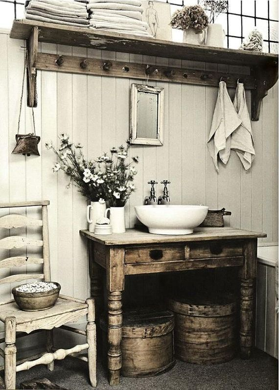 I absolutely LOVE this primitive table. Great color! Great textures! The beautiful green and brown colors are charming!! This rustic table will be fabulous in a farmhouse bathroom renovation. Just imagine the history of this table! Will it by yours? See examples of similar tables converted to bathroom vanities.  28 tall x 35-3/4 wide and 23-1/4 deep. We will make adjustments to the drawer for pipes. Top will be clear coated.  This primitive table is sturdy and in very good condition for her…