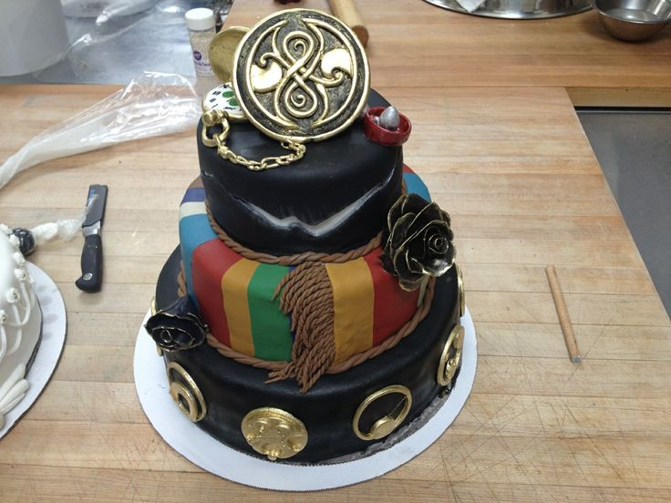 Awesome Doctor Who cake! Love the scarf, the crack in the wall, and the Gallifreyan symbols!