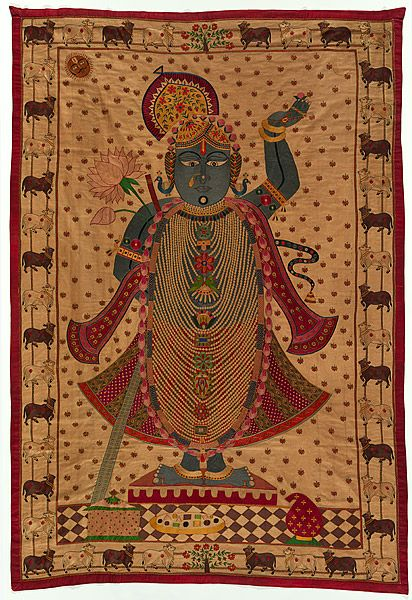 "Hindu Lord Krishna as Shrinathji who at age 7 lifted the Govardhan hills to save the people; shrine hanging [pichhavai]. late 19th C. cotton, silk embroidery 71.3"" x 48"""