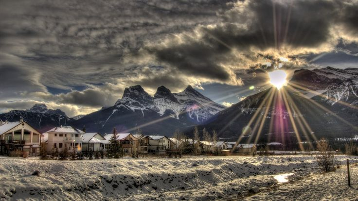 Seeing the sunset over the Three Sisters in Canmore. | 14 Sites In Alberta That Will Make You Feel Alive