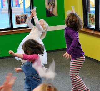 Preschool Large Group Activity: Winter Movement with Snowflakes made out of white netting