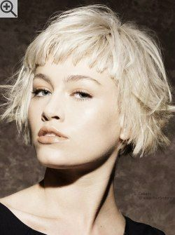 Very short bob with bangs that cover half of the forehead. With texture and rugged cutting lines.