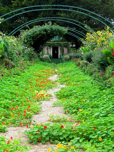 Monet's house at the end of a flower filled pathway in Giverny, France.
