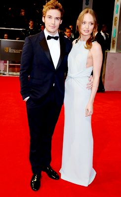 Sam Claflin and wife Laura Haddock attend the EE British Academy Film Awards 2014 at The Royal Opera House on February 16, 2014 in London, England