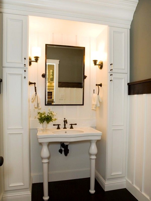 Perfect guest bath - great storage with a wonderful sink.  Love the bead board and sconces too!