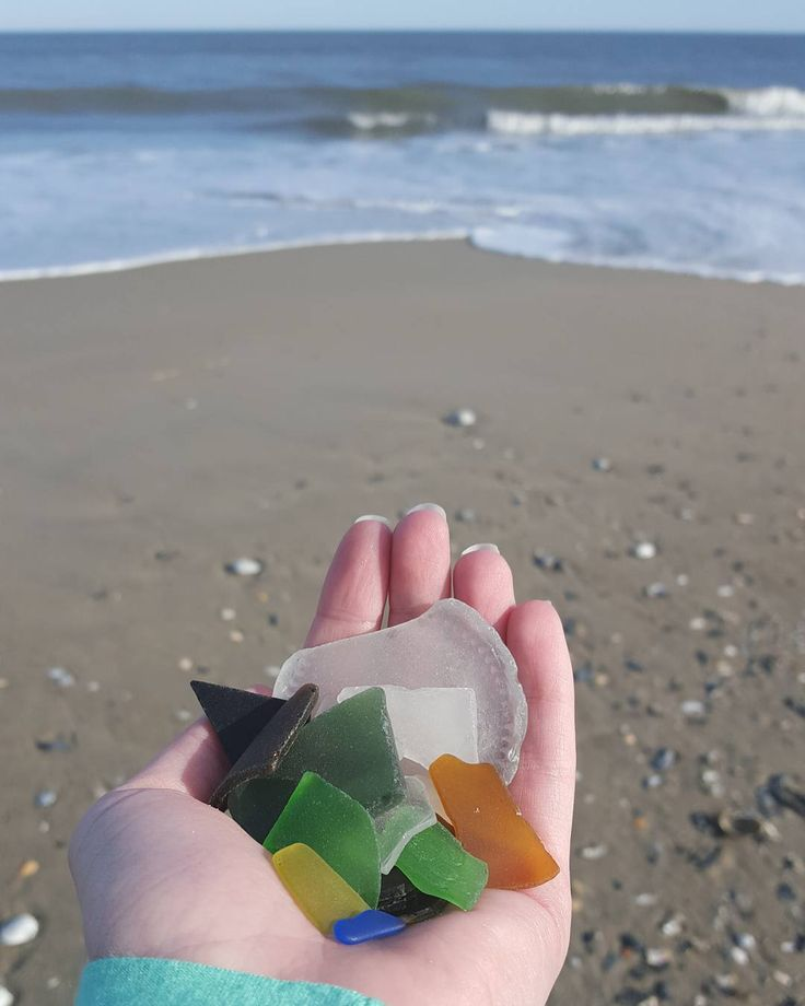 Who loves searching for sea glass when they visit the Outer Banks? #OBX #OuterBanks #OBXLove #SeaGlass #BeachGlass #Corolla