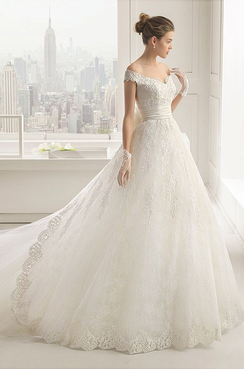 A romantic off-shoulder lace ball gown wedding dress from Rosa Clara 2015 bridal collection.