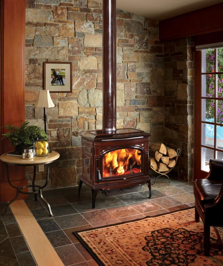 Lopi Cape Cod Wood Stove - Brown    I know this isn't a reading nook but it would be an excellent place to curl up and read or do paperwork.