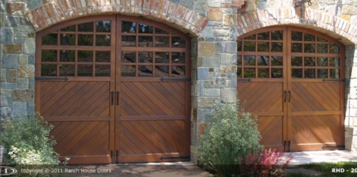 We are also one of the largest custom wood garage door manufacturer in the USA. Select from our extensive library of real wood garage door designs or bring your own design or idea and we'll custom design your wooden garage door for you. We also manufacture faux wood garage doors. http://www.ranchhousedoors.com and http://www.faux-wood-garage-doors.com
