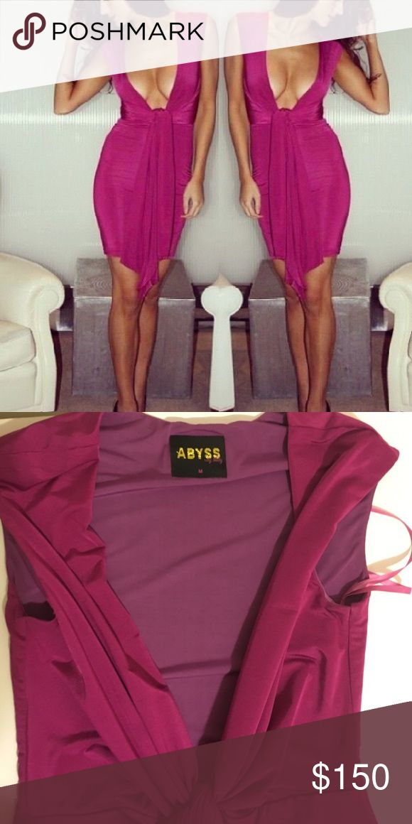NEW LISTING* Sexy Low Cut Sash Fuschia Dress Sexy, high quality dress from Just Enaj. Kylie, Kim @ Khloe Kardashian are among the many celebrities who wear these dresses. Bright Fuschia dress with a plunging neckline & a large sash. Size medium Just Enaj Dresses Midi