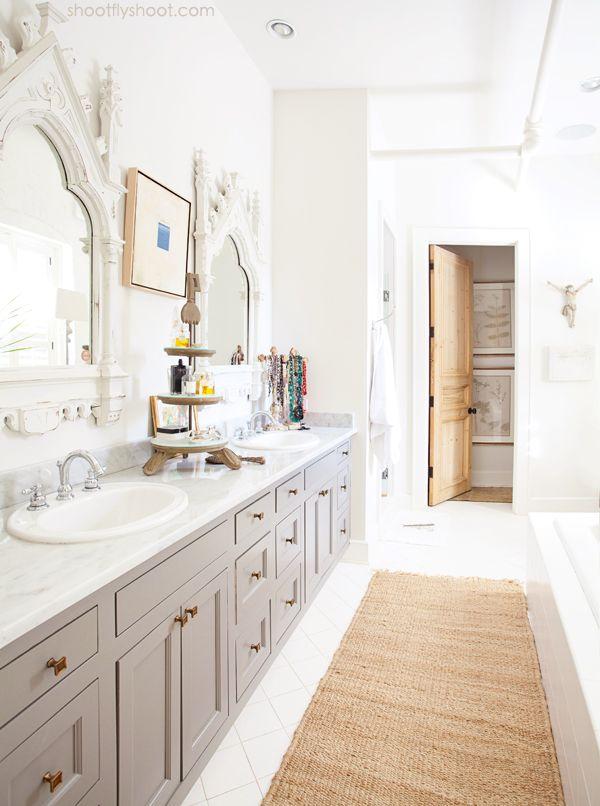 gray vanity, antique brass knobs, ornate distressed white mirrors