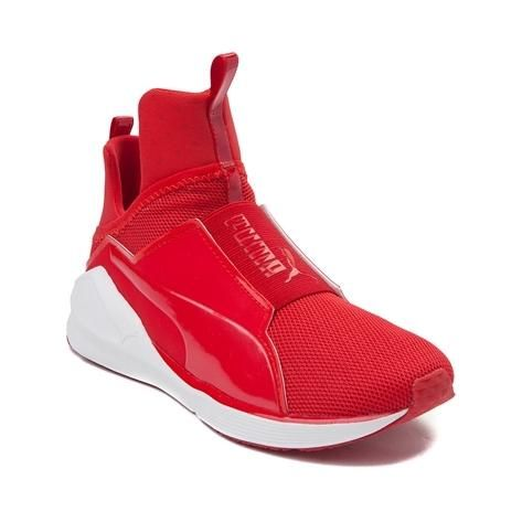 This season, Puma collaborates with Kylie Jenner for the fashion forward Fierce Athletic Shoe. Blending high-fashion with athletic appeal, the Fierce Athletic Shoe is fully loaded, with a contemporary design, lightweight mesh uppers, and rubber outsole with pivot points for enhanced performance.   <br><br><u>Features include</u>:<br> > Slip-on design with pull loops at heel and tongue<br> > Lightweight and breathable mesh uppers with synthetic overlays for durability<br> > Elastic vamp…