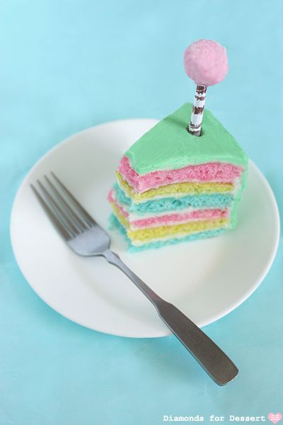 The Lorax Cake: a multicolored layer cake decorated with cotton candy truffula trees
