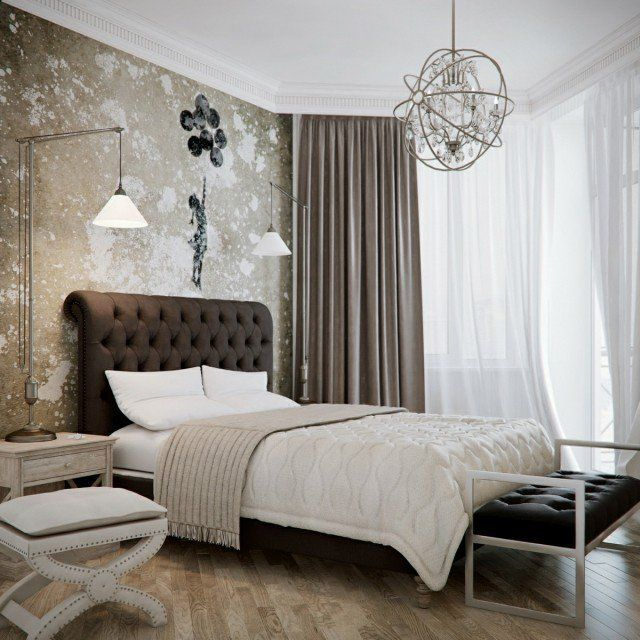 une belle chambre à coucher en beige et marron clair et un luminaire moderne