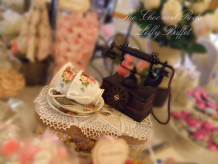 The vintage telephone really completed the table - and the tea cups just added to the theme.   www.facebook.com/thechocandrocklollybuffet www.thechocandrock.com