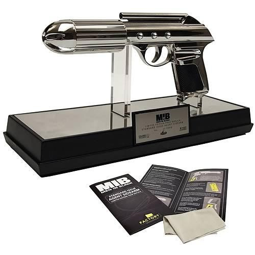 "A sleek, iconic weapon carried by everyone from Will Smith's Agent J to Tommy Lee Jones' Agent K, the J2, or J-Gun, has been recreated here in full scale prop replica form after exhaustive and careful study of the original props to ensure maximum authenticity. Comes with a museum quality display stand, acrylic cover, numbered limited edition plaque, certificate of authenticity and detailed prop story booklet. Limited edition of 1,000 pieces. Requires 2x ""AA"" batteries, included."