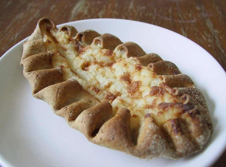 Karelian pasty (karjalanpiirakka) is a traditional Finnish dish made from a thin rye crust with a filling of rice. Butter, often mixed with boiled egg (eggbutter or munavoi), is spread over the hot pastries before eating.