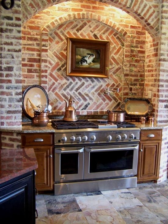 Interior brick arch kitchen...don't like Brick but love this instead of hood with travertine stone etc...