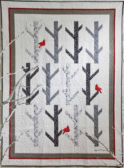 White Birches quilt, stunning with the cardinals - would love to find out who made this one!