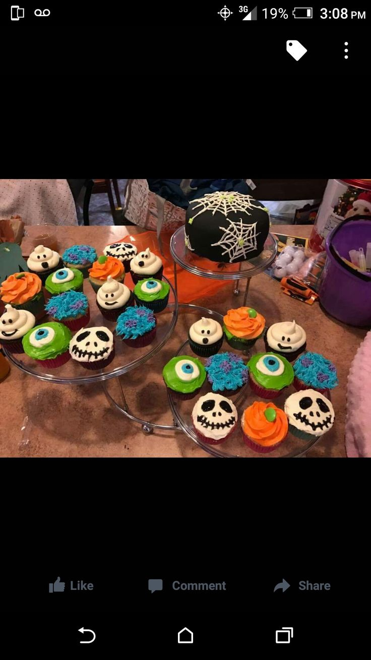 Halloween cupcakes and cake spider web with spider cake cupcakes ghost emoji, pumpkins, and Disney Mike wasowski, sully, Jack skellington cupcakes