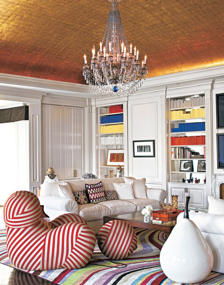 A vintage chandelier is suspended from the 14-karat gold leaf ceiling in Max's office. Gaetano Pesce's whimsical Up 2000 series chair and ottoman from B&B Italia sit on a rug designed by Paul Smith for The Rug Company.